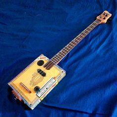 Hey, I found this really awesome Etsy listing at https://www.etsy.com/listing/543119950/electric-cigar-box-guitar-3string-double