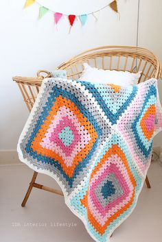 Love that it's just four big squares. Colorful baby blanket by IDA Interior LifeStyle, via Flickr