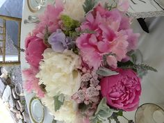 Wedding centerpiece white and pink peonies, lavender,durst miller and sweet peas