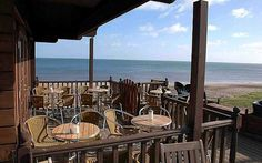 Who needs foreign beaches when the sun shines on the English seaside? With temperatures soaring, here are some of our favourite beachside cafés and bars. England, Seaside, United Kingdom, Places To Go, Pergola, Europe, Outdoor Structures, Cornwall, Beach