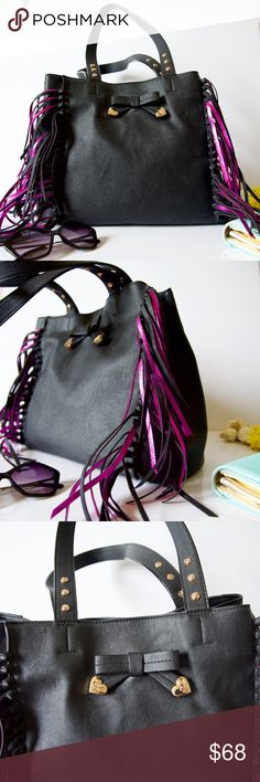 """Betsey Johnson Fringe Shoulder Bag Boho style bag in black with metallic pink and black fringe detail. Studded top handles, with a 9.5"""" drop. Magnetic closure with a snap bridge strap. Cute front bow detail, with gold hardware. Fully lined with 2 interior slip pockets and 1 interior zip pocket. 16"""" W x 12"""" H x 7"""" D. Used a few times, still looks like new! Betsey Johnson Bags Shoulder Bags"""