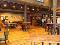 Mark Ryan Winery Review (Washington) - Stepping into the Mark Ryan Winery tasting room in Woodinville's Tourist District is like stepping into a teenage boy's dream garage - a popular teenage boy with a budget for fun.