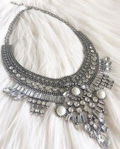 "- silver tone statement necklace, - clear ""crystals"" and faux pearls, - feature by many bloggers, - popular design."