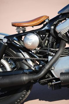 """Built by Lluís Ibañez Casabon of L.A. Motorcycles in Barcelona. Based on a 2006-model Sportster 883 Low. Retro bobber flavour, custom tank from Salinas Boys, pre-War Harley VL style springer forks, matching Phantom headlight. Rear suspension is more modern, with 11"""" shocks from Progressive, nestling alongside a """"Flat Bob"""" rear fender and a replica pre-War taillight. Avon Speedmaster tires on 16"""" rims complete the look. With only the grips and leather seat providing a touch of colour."""