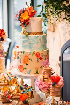 A simply breathtaking sight! Vibrant colours, sugar flowers, and floral topped sweets! A truly stunning and seamless setup! Pretty Cakes, Cute Cakes, Beautiful Wedding Cakes, Beautiful Cakes, Bride To Be Decorations, Bridal Shower Photography, Quinceanera Cakes, Wedding Cakes With Cupcakes, Painted Cakes