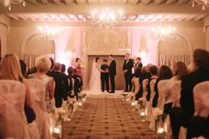 Ceremony at the Coronado Ballroom flowers by the special event florist photos by Clary Photo