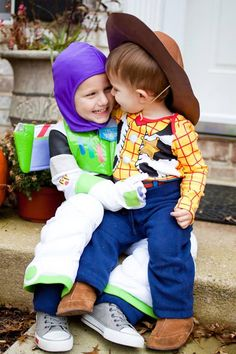 These brothers are too cute in their Buzz Lightyear and Woody Halloween costumes!