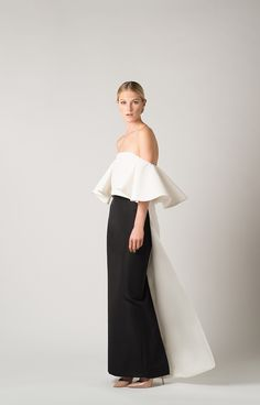 Straight neckline Ruffled off-the-shoulder sleeves Floor length cape design Concealed back zipper Fully lined Shell: 100% Silk Lining: 100% Polyester Dry clean only …