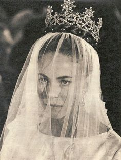Princess Claude of Orléans wearing the Aosta-Savoy Knot and Star tiara on her wedding day.