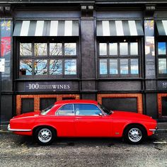 Jaguar   XJ   Red classic car   Photo by Luke Fonfara -- Curated by: Enterprise Glass Ltd   1017 Richter St. Kelowna B.C.   778-478-0598