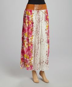Don this maxi skirt with floral flair and stand out from the crowd. The faux belt anchors the flowy, pleated design making it a comfortable and chic choice for any day calling for a feminine ensemble.