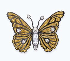 A SUPERB COLORED DIAMOND AND STEEL BUTTERFLY BROOCH, BY CARTIER