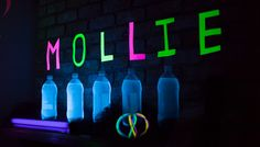 Tonic water and neon poster paper glows in the dark under a blacklight. See the post at: http://poppyandjune.com/2015/08/09/go-with-the-glow/