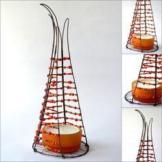 Beaded wire tea light holder.