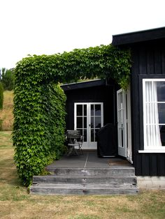 side porch with bushy vines (like virginia creeper) @victoria8 this makes me think of putting a pergola alongside the garage for a little shady poolside seating.