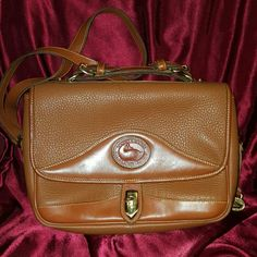 Dooney and Bourke brown leather large crossbody This is an authentic Dooney and Bourke brown leather large crossbody. This bag is vintage. Still in great shape. Little signs of wear Dooney & Bourke Bags Crossbody Bags