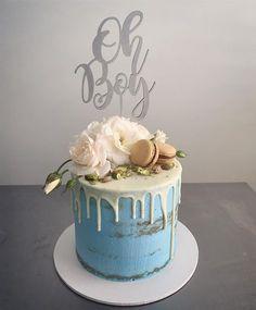 BABY SHOWER CAKEvanilla cake with Choc ganache layers and semi naked blue buttercream. Salted caramel macaroons pistachios and fresh roses. . . . #ohboy #vanillacake #chocolateganache #babyshower #babyshowercake #bluecake #macarons #babyboy #boybabyshowercake #putacakeinit #penrithcakes #sydneycakes #instacake