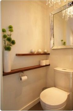 shelf beside the toilet wall to wall instead of behind. shelf above - shelf beside the toilet wall to wall instead of behind. shelf above shelf beside the toilet wall to wall instead of behind. shelf above Shelves Above Toilet, Bathroom Shelves, Bathroom Wall, Shelf Wall, Mirror Shelves, Wall Mirror, Bathroom Storage, Behind Toilet Storage, Bathroom Interior