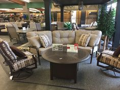 Woodard - Cortland Curved Sofa. Swivel Lounges and Fire table available as additional items.