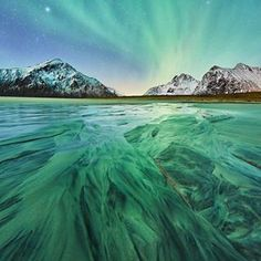 Green sand? Photography by © (Johny Goerend) I already went to Skagsanden beach during the day to search for spots and ideas I could use during the night. #auroraborealis #lofoten #norway #skagsanden #beach #northernlights #aurora #travel #nature #travelphotography #instatrip #mytravelgram #nomagme