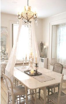 Shabby dining; 1st I've seen a canopy used at a table; not practical for a full table, but would be romantic for 2!