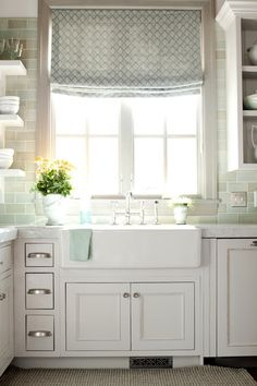 White kitchen with a farmhouse sink and teal backsplash White kitchen with a farmhouse sink and teal backsplash Always wanted to learn to knit, but u. kitchen tools White kitchen with a farmhouse sink and teal backsplash Kitchen Window Treatments, Home Kitchens, Kitchen Remodel, Sweet Home, Kitchen Inspirations, Home Decor, House Interior, Alice Lane Home, Farmhouse Sink