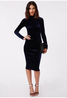 With luscious long sleeves, flattering bodycon fit and a standout silhouette in a dark and deep navy colour way this velvet dress is the one. Chanel major velvet vibes this season in this chic high neck midi dress. Team this with lace up he...