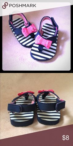 Navy Blue & White Striped Sandals w/ Pink Bow Navy Blue & White Striped Sandals w/ Pink & White Polka Dot Bows. Velcro back strap, easy to put on and take off. Ridged bottom (as seen in the photos) so no slipping and falling. Worn three times maybe. GREAT condition! 👍🏽🎀 Shoes Sandals & Flip Flops