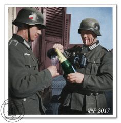 Wehrmacht soldiers celebrate a victory with a nice bottle of Champaign they had found somewhere along their Blitzkrieg to Paris. Summer, 1940.