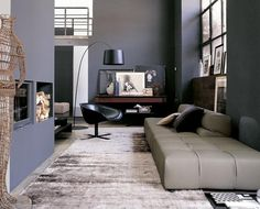 A deep cushioned ottoman could work smartly when used as a standalone piece elsewhere in a living room scheme