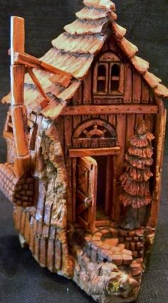 Cottonwood Bark Gnome House with carved tree near entrance.  Carved by N. Minske.