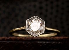 love the shape, love the engraving along the sides in gold LOVE http://eriebasin.com/1920s-0-72ct-diamond-hexagonal-ring.html