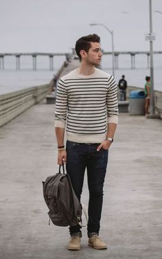 round neck sweater, stripes are nice. dark narrow leg jeans, tan boots.