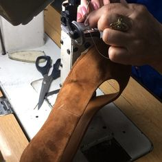 In Spain Maribel is threading the needle and continues to stitch the upper leather with the lining before the shoe is lasted #miistaproductionspain #miista #shoemaking