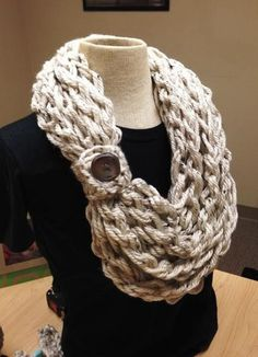 Kay's crochet rope scarf is made with 2 strands of bulky weight yarn and finished with a real bamboo button. These scarves are made in one long crocheted rope.