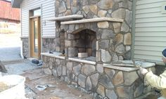 Masonry fireplace under construction. Village Craft Iron & Stone, Inc.