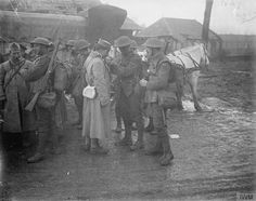 British and French soldiers gather together in Ham on the Somme as the 36th Division takes over part of the line from the French, 15 January 1918.