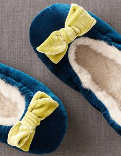 Fur-lined peacock velvet slippers with chartreuse bows from Boden. $48.00.