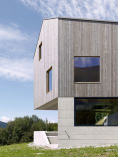 In the swiss mountains has been built this chalet with a contemporary  style. Inside the building the architect has used only two material: wood  and concrete. ARCHITECTURE