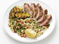 Pork and Zucchini with Orzo : Pounded pork and thin-sliced zucchini, as well as quick-cooking orzo, make it easy to serve a three-part meal in no time.