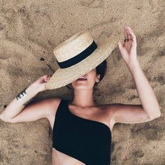 Straw hat with black ribbon and asymmetrical black bathing suit top Girl black beach sand beige gold summer swim Beach Photography Poses, Beach Poses, Black Bathing Suit Top, Bathing Suits, Foto Casual, Sun Hats For Women, Boater, Summer Pictures, Black Ribbon