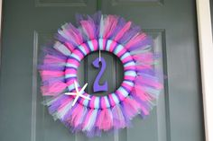 Pretty pink and purple tulle wreath!  See more party planning ideas at CatchMyParty.com!