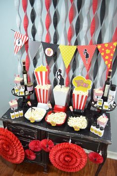 Ready To Pop Baby Shower Popcorn Party. What a great party idea. Look at the vibrant colors of red, black and white. Perfect trendy theme for your Ready To Pop Baby Shower Theme. Great Centerpiece Ideas and Wall Decor