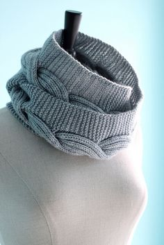 nice eternity cowl - garter stitch with a reversible (rib-stitch) cable up the middle.