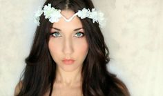 Boho Bride' Stunning clusters of pure white flowers entwined upon a raffia coated wire frame designed to wrap around the head coming to a striking 'V' on the forehead for a true bohemian look. $59.95 including gift box and FREE shipping in Australia. http://www.fascinatorsdirect.com.au/bridal/tropical-bridal-headpieces/boho-beauty-tropical-bridal-headpiece.html