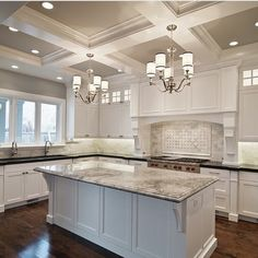 White Kitchen. Dark Floors. Large Island. Island Design.