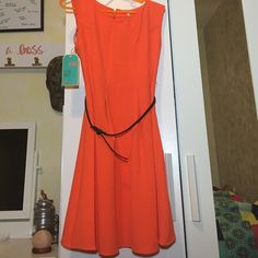 GB Orange party dress Orange mid-length dress with black belt and a zipper back. Brand new, never worn, retail tags still on! Giani Bernini Dresses Midi