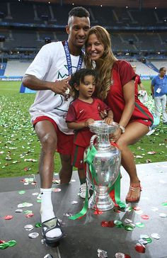 #EURO2016 Luis Nani of Portugal his wife Daniela Martins and their son pose with the trophy following the UEFA Euro 2016 final match between Portugal and...