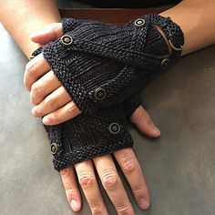His Lordship's Steampunk mitts are manly fingerless mitts, knit in the round in double knit (8ply) yarn. Brass buttons and a buckle cuff add some fun steampunk finishing. Mitts are knit in one piece, with stitches picked up for the buckle band at the end.