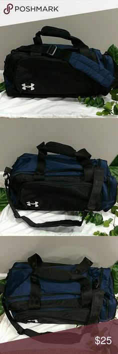 """UNDER ARMOUR DUFFLE BAG EXCELLENT LIKE NEW CONDITION. ABSOLUTELY NO ISSUES NO STAINS NO MARKS NO RIPS NO SCUFFS NO SIGNS OF WEAR AT ALL! BLACK AND BLUE WITH UNDER ARMOUR LOGO ON FRONT AND SO LOVER HANDLE STRAPS AND ON SHOULDER STRAP. CAN BE USED FOR WOMEN, MAN OR KID. EXCELLENT UNDER ARMOUR DUFFLE BAG! APPROX 22X11X8"""". Under Armour Bags"""